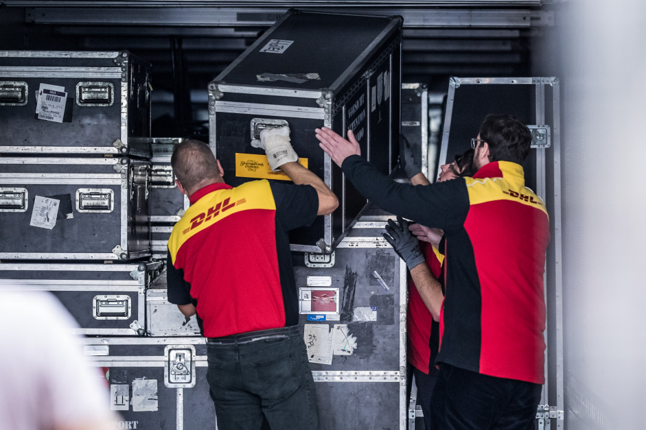 DHL staff unload the valuable instruments and other equipment of the Gewandhausorchester