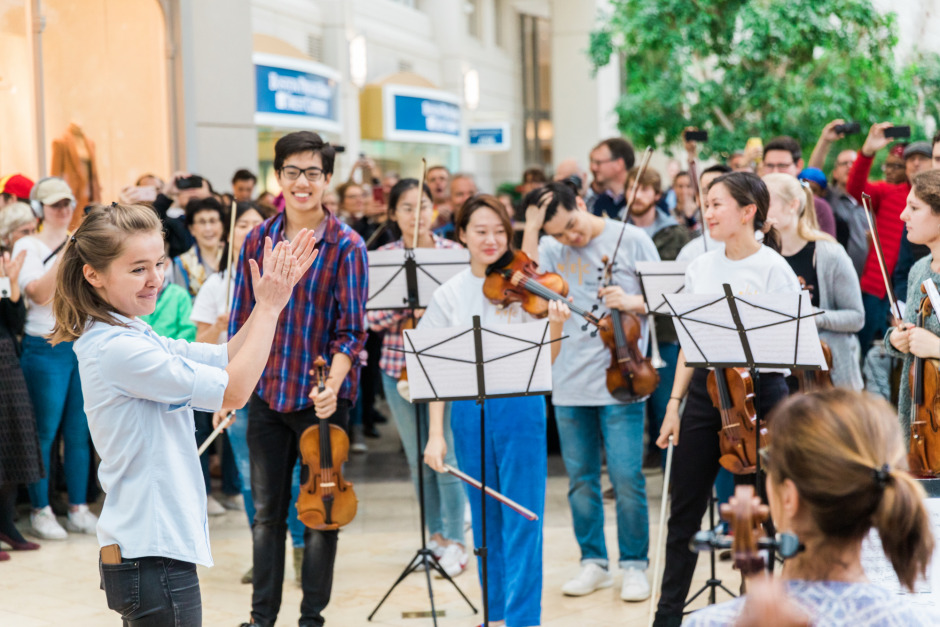 Russian-born Anna Rakitina, Boston Symphony Orchestra's newest assistant conductor, thanks her flash mob volunteers for a great performance.